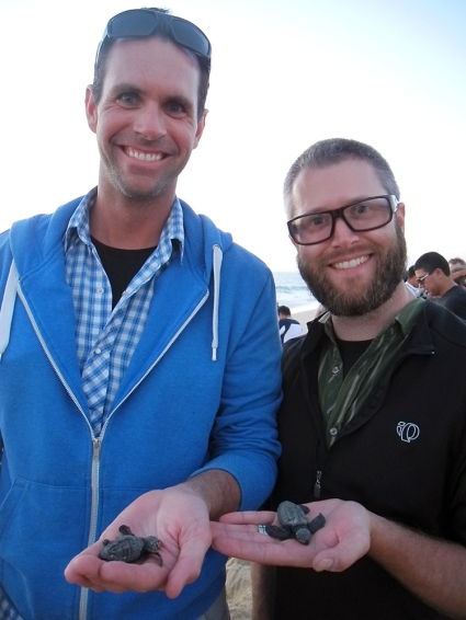 Brian and Matt holding their sea turtles.