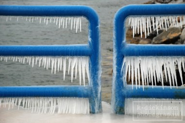 Icicles form on the railing of a pier on Lake Michigan. December 2008.