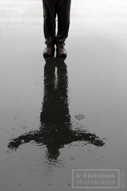 Reflection of a Man on a Rainy Day