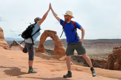 My brother and I at Delicate Arch, Arches NP. Photo by Matt Dickinson.